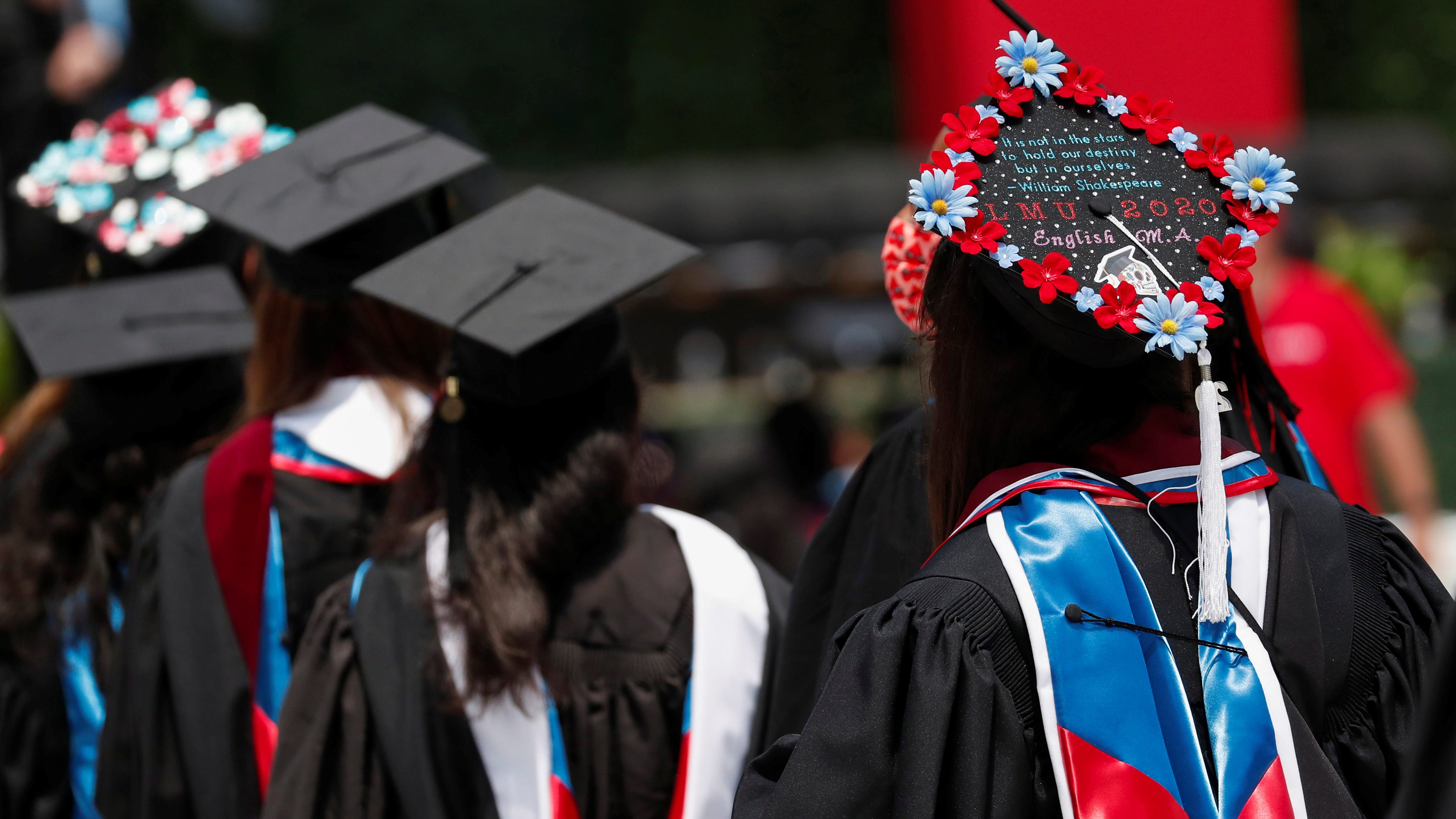 Graduates parade during Loyola Marymount University's 109th commencement for graduating classes of 2020 and 2021 at SoFi Stadium in Inglewood, California, U.S., July 31, 2021.