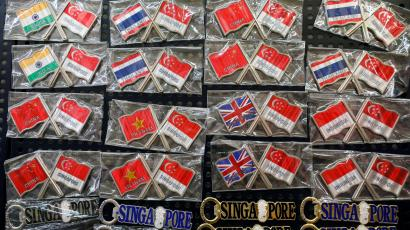 An image of souvenir pins featuring flags of China, Indonesia, India, Thailand, Vietnam and the United Kingdom in Singapore