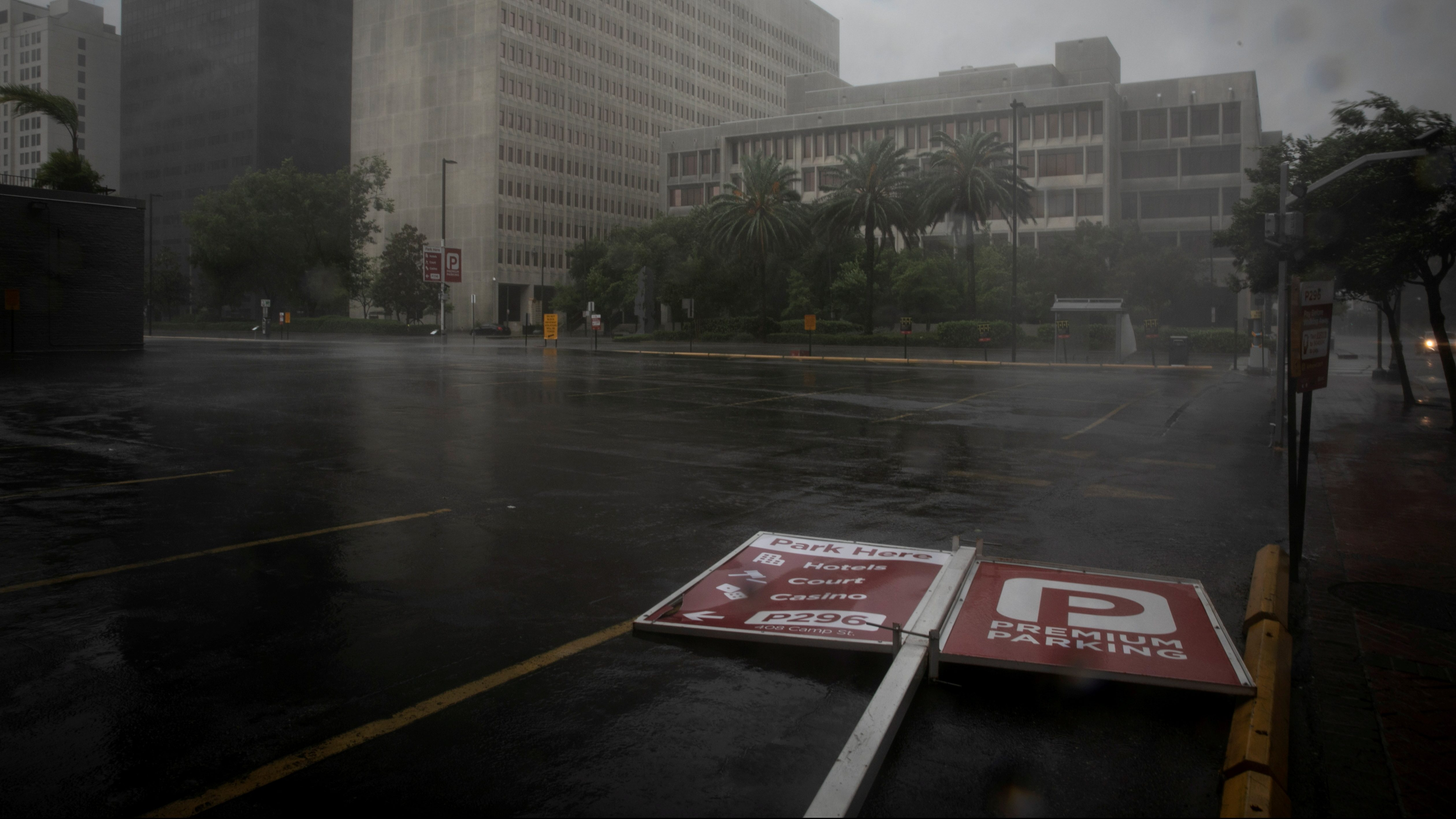 A parking sign lies in the street as Hurricane Ida makes landfall in Louisiana, in New Orleans