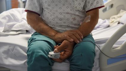 A man with Covid-19 in the hospital