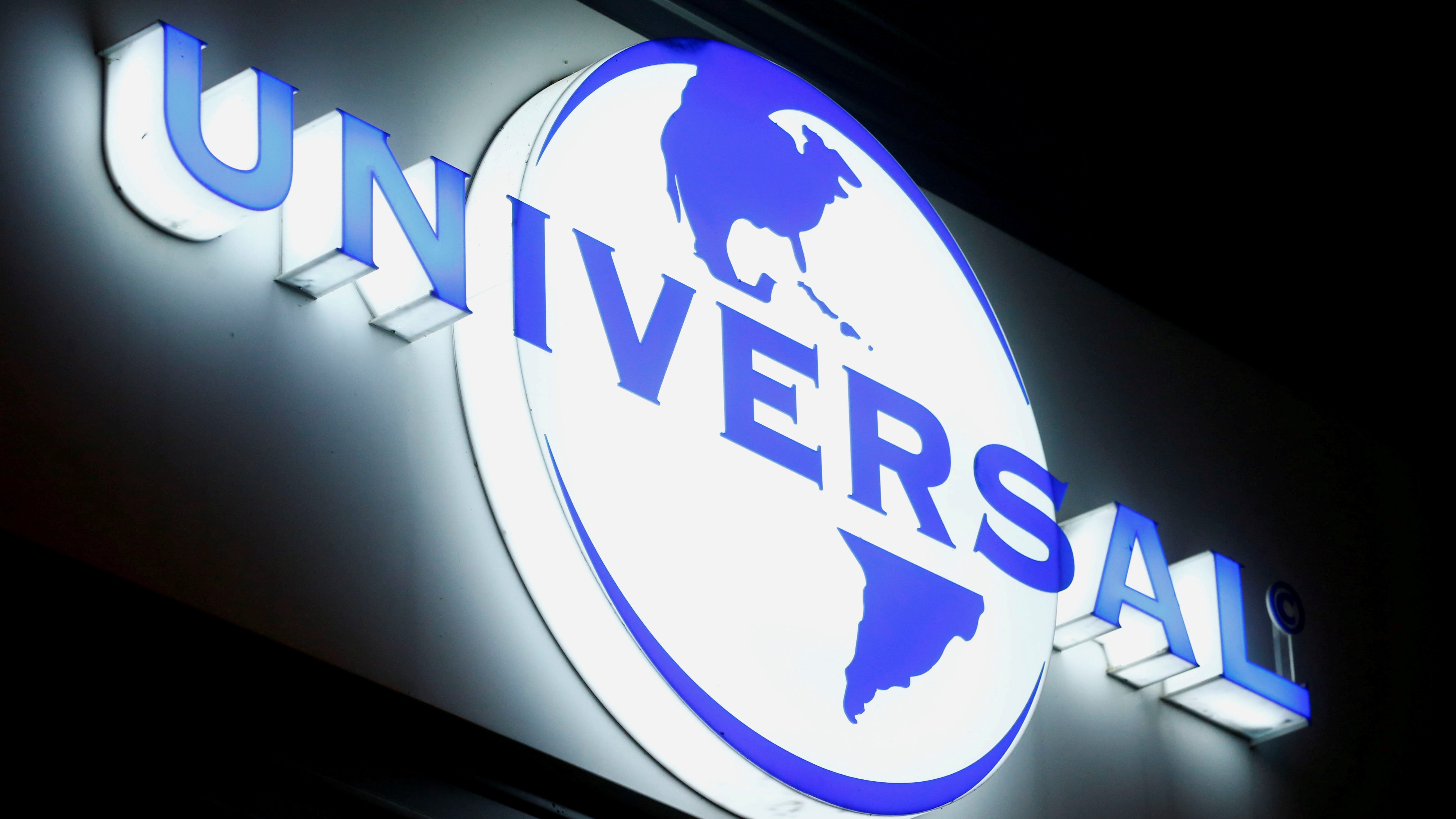 FILE PHOTO: The logo of Universal Music Group (UMG) is seen at a building in Zurich, Switzerland July 20, 2021.