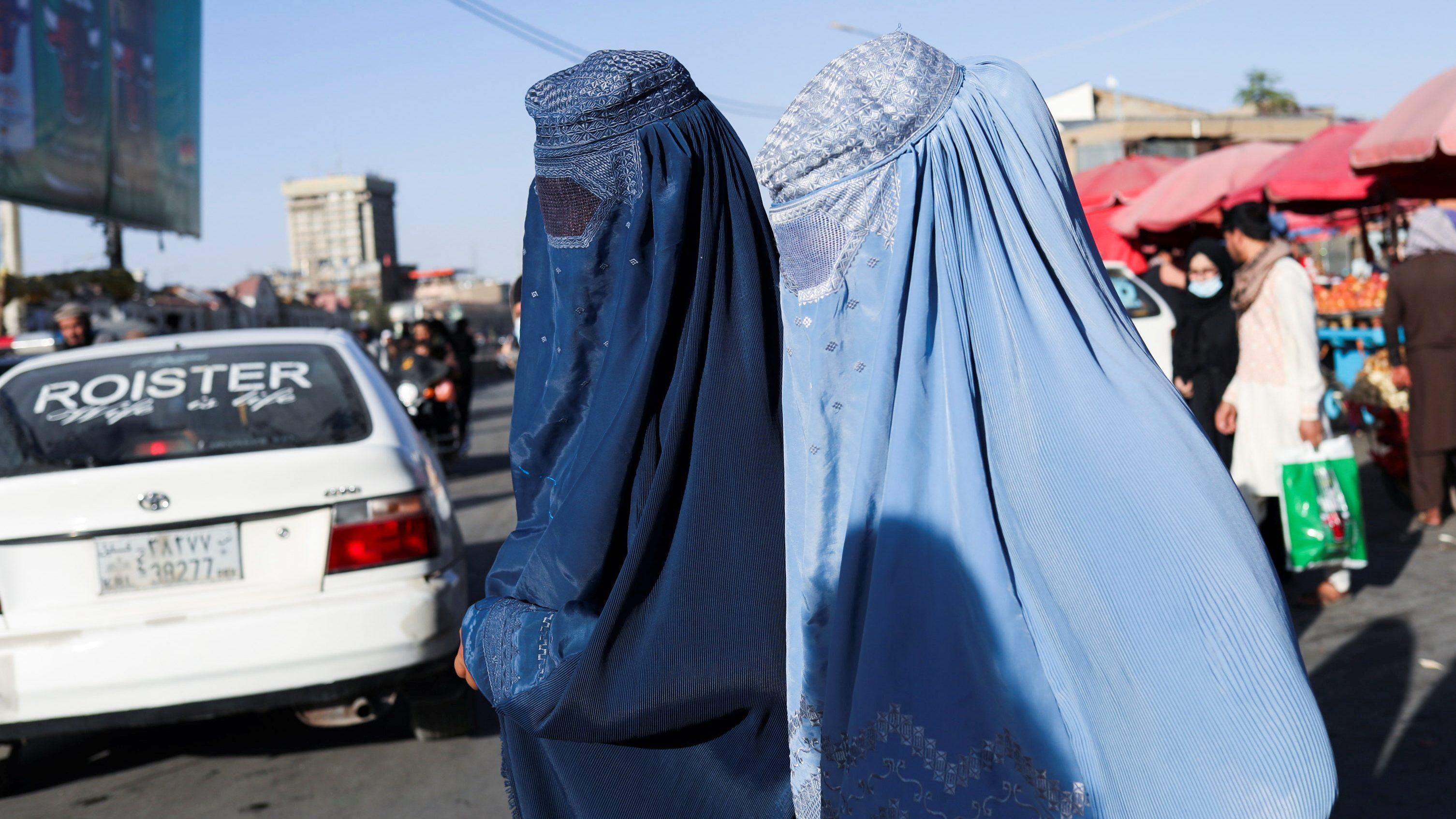 Afghan women walk down a street in Kabul