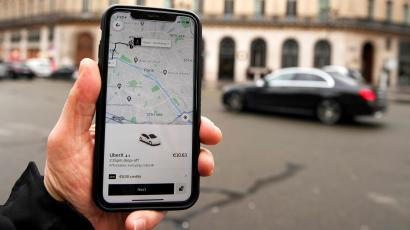 A photo Illustration shows the Uber application on a mobile phone in in central Paris, France.