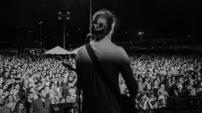 Photo taken from behind Adam Met of AJR on stage, looking out into the audience, at the Basilica Block Party Festival in Minneapolis, September 2021.