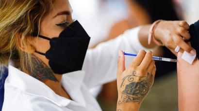 Ely Herrera, a health worker, injects a dose of the Pfizer-BioNTech coronavirus disease (COVID-19) vaccine during a mass vaccination programme