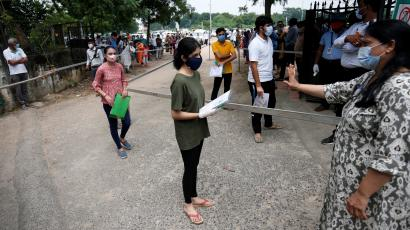 Students wearing protective face masks arrive at an examination centre for National Eligibility cum Entrance Test (NEET), amidst the spread of the coronavirus disease (COVID-19), in Ahmedabad, India