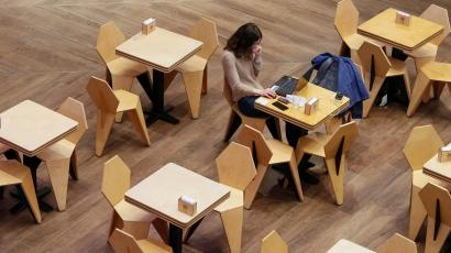 A woman uses a laptop at a cafe in the Central Universal Department Store (TsUM) in Kiev, Ukraine