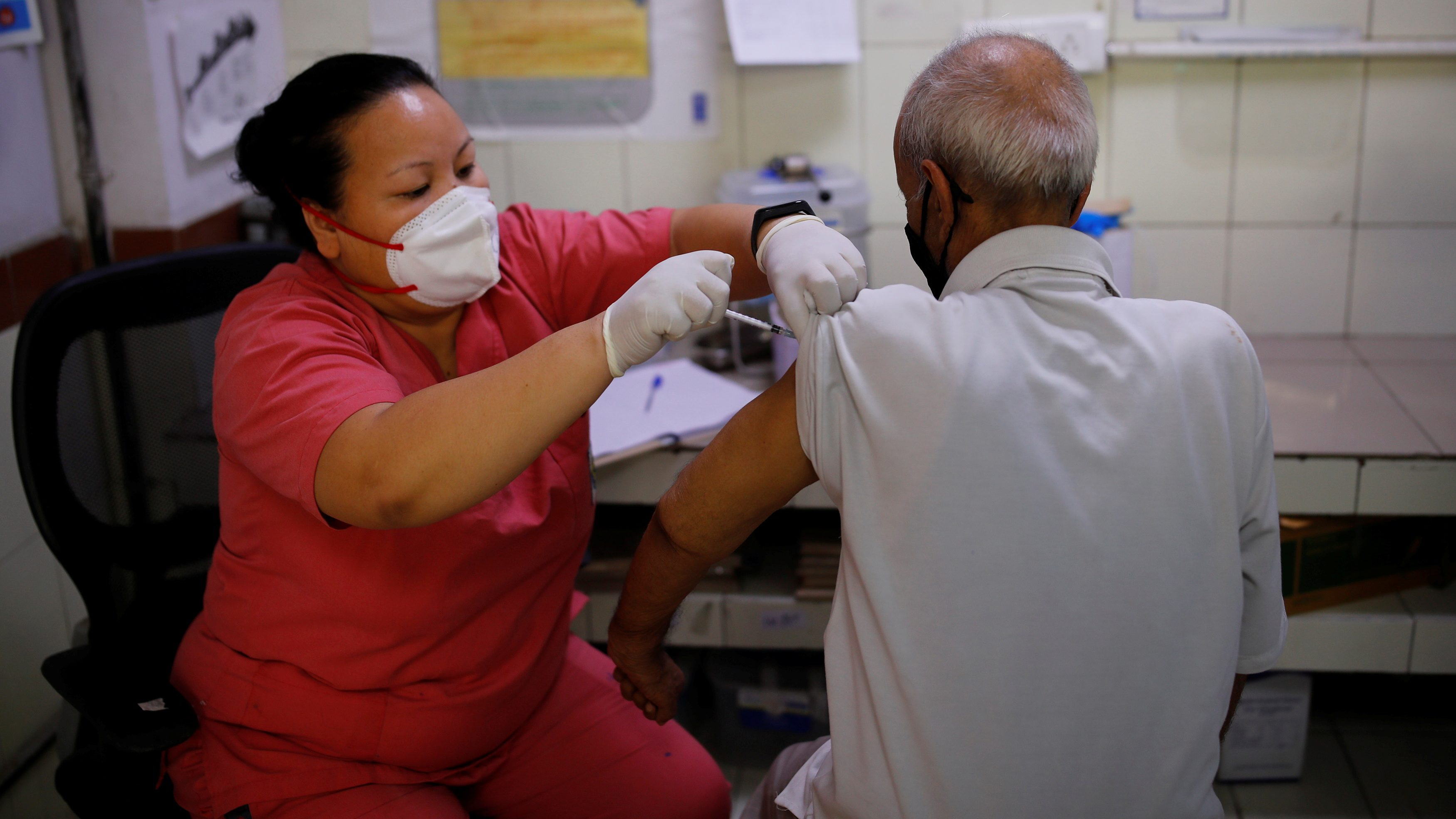 A 69 year old man receives a dose of COVISHIELD vaccine, a coronavirus disease (COVID-19) vaccine, manufactured by Serum Insitutue of India, at a hospital, in New Delhi