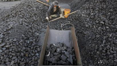 A villager selects coal at a coal mine in Heilongjiang province, China.