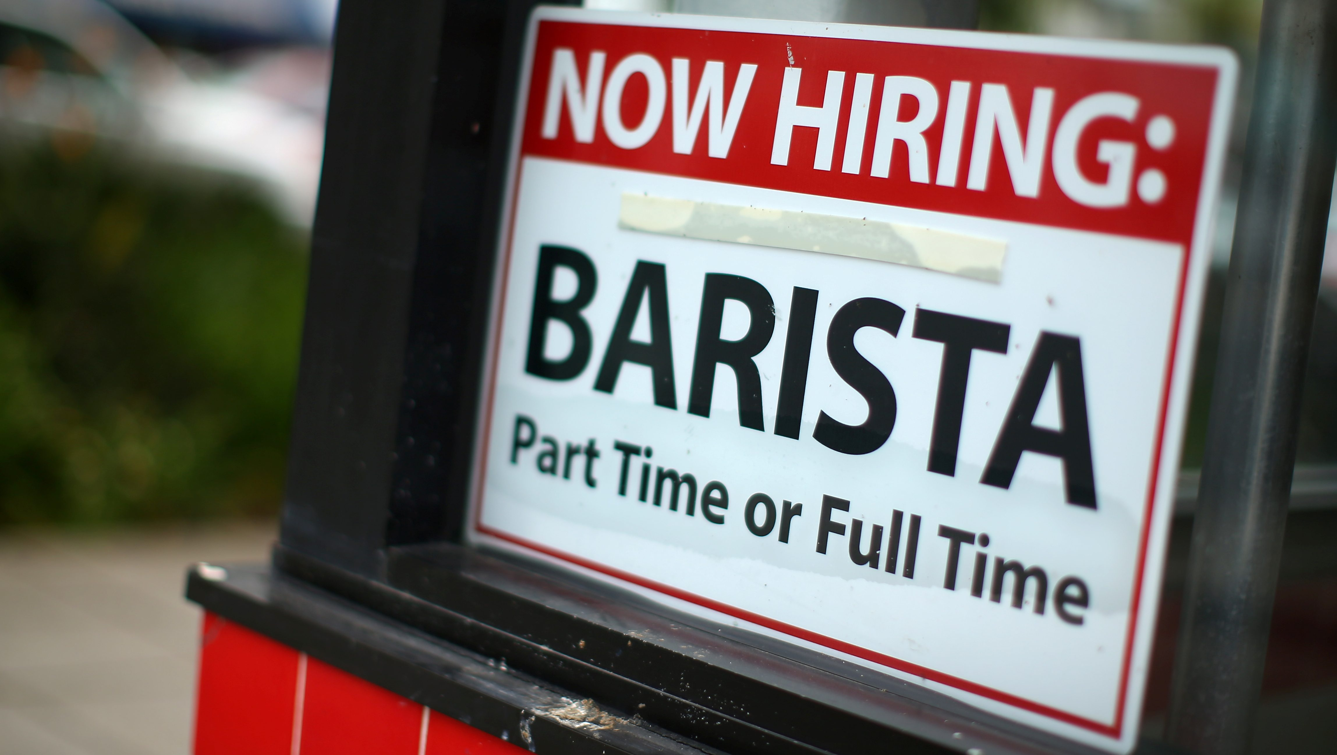 Hiring sign for a part-time or full-time barista on a restaurant window.