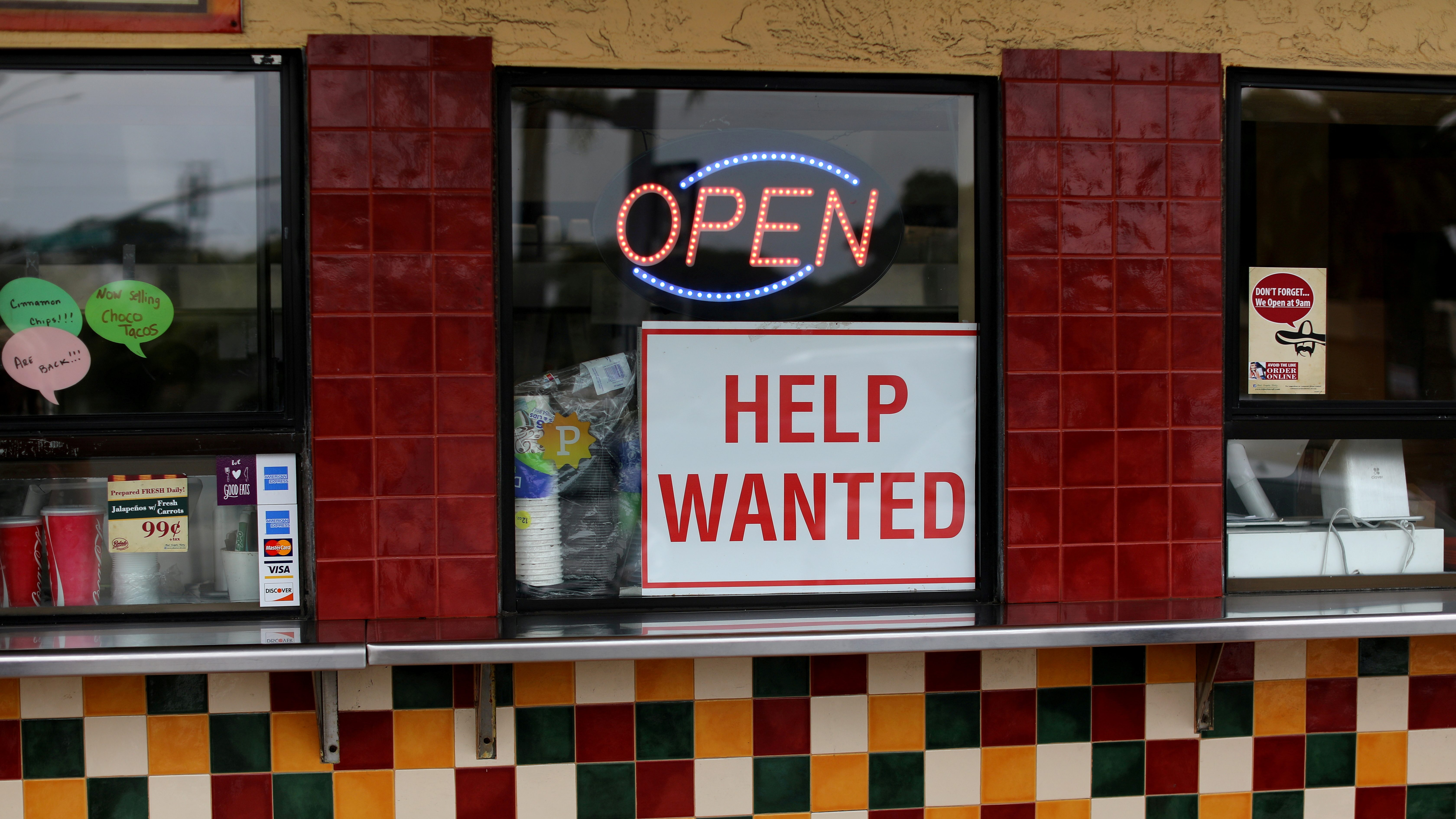 A help wanted sign is posted at a taco stand in Solana Beach, California, U.S