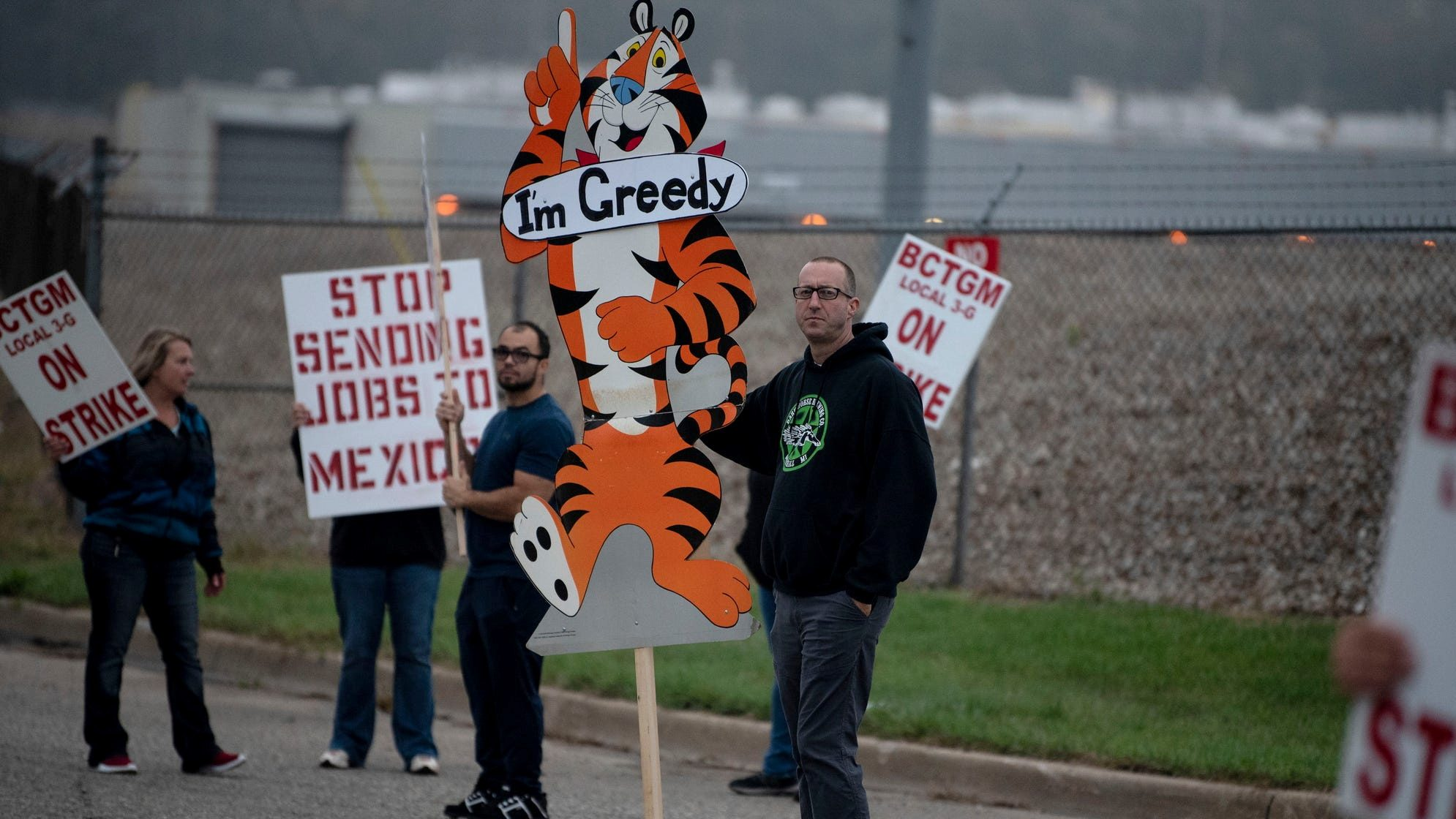 First shift worker Travis Huffman joins other BCTGM Local 3G union members in a strike