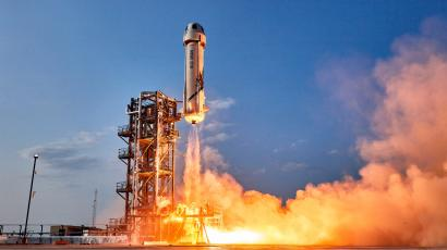 A Blue Origin New Shepard rocket takes off carrying four passengers, including Jeff Bezos, on July 20, 2021.