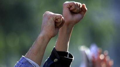 Two fists raised in solidarity