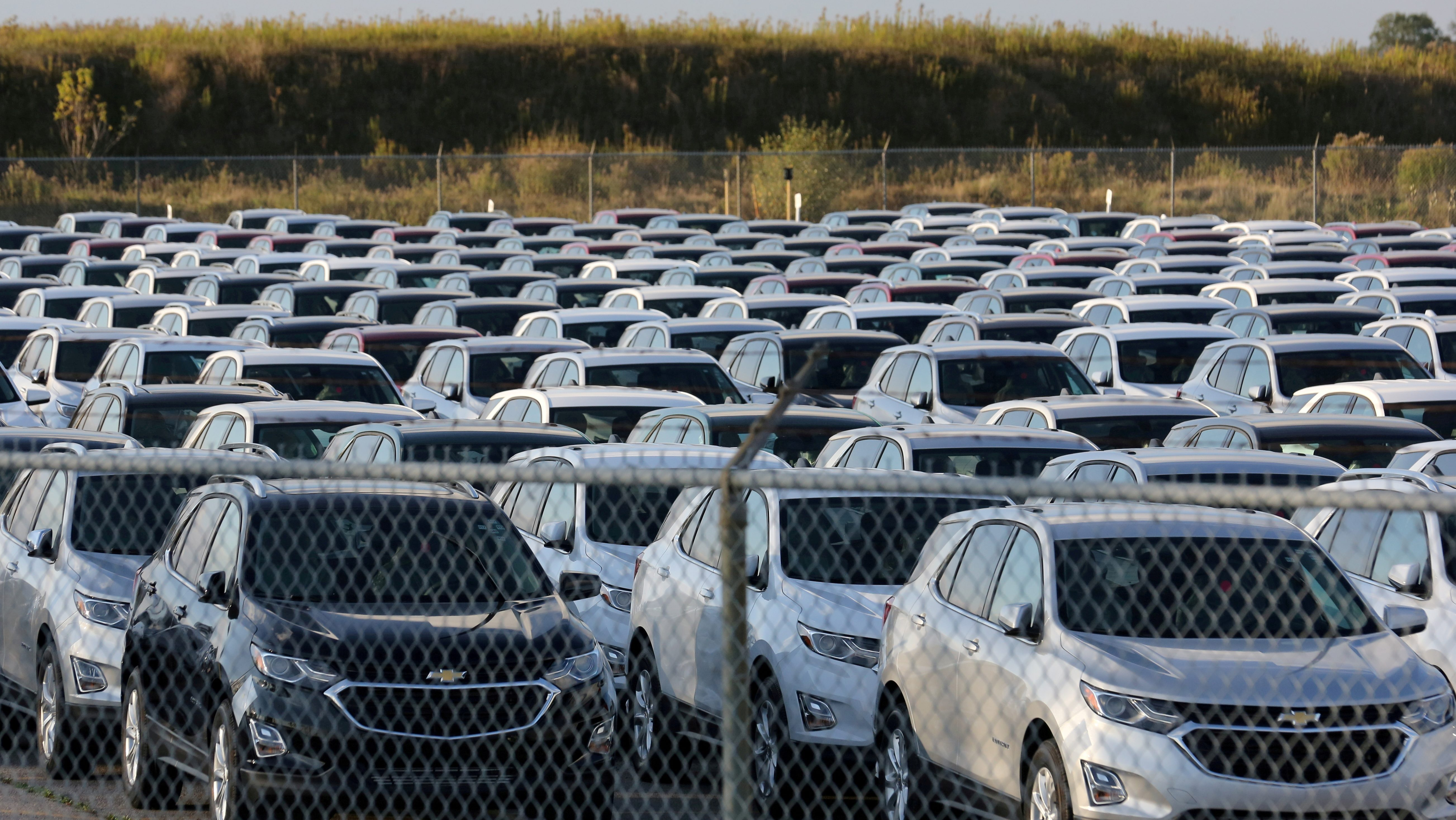 Chevrolet Equinox SUVs are parked awaiting shipment next to the General Motors Co (GM) CAMI assembly plant in Ingersoll, Ontario, Canada October 13, 2017.