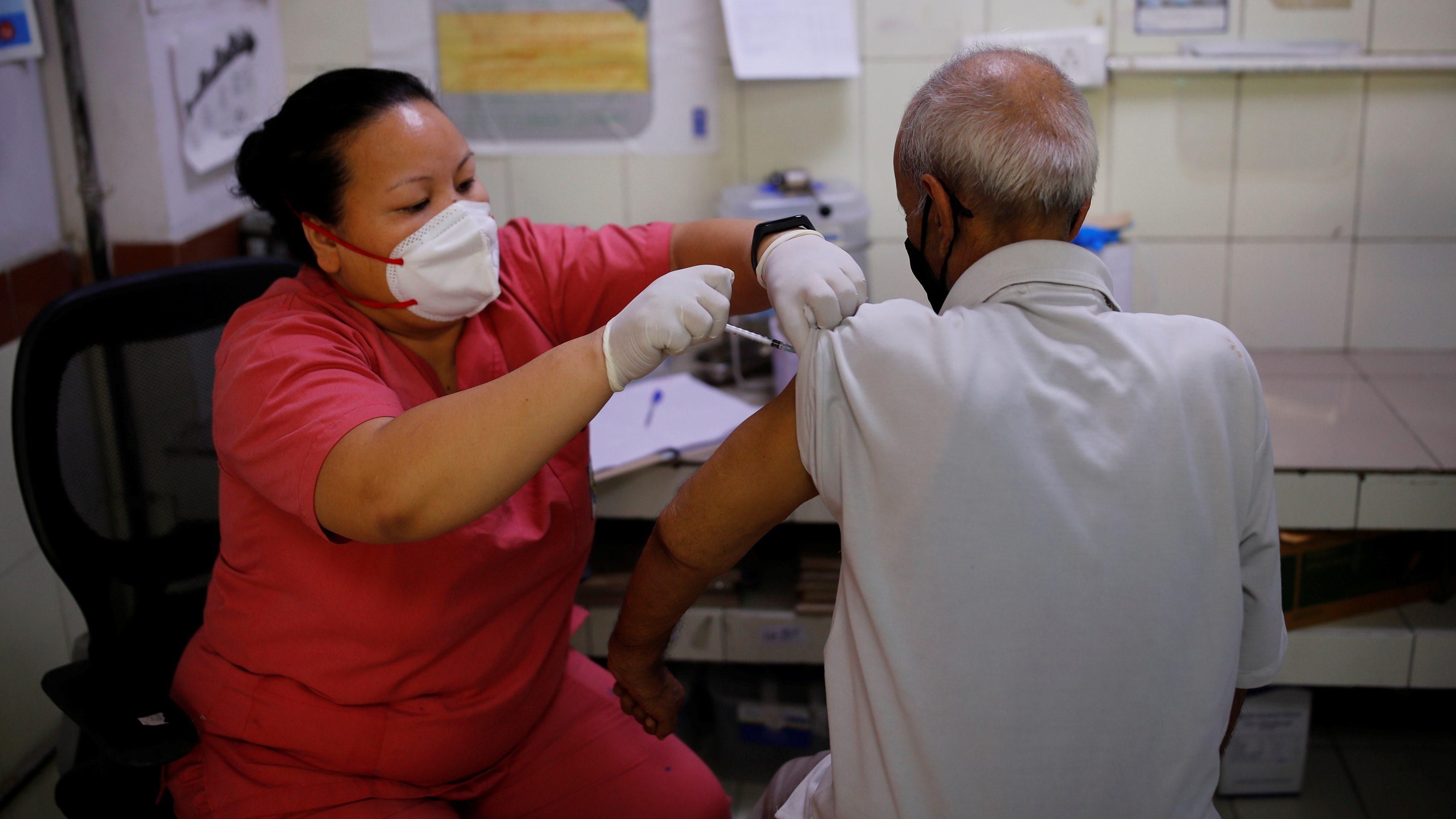An elderly man received a dose of the Covishield Covid-9 vaccine in New Delhi, India.